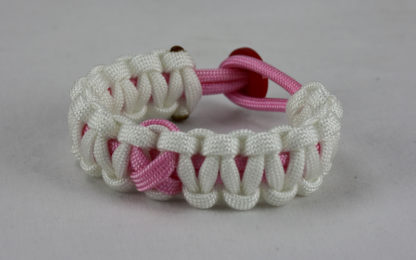 soft pink and white breast cancer support paracord bracelet w red button back soft pink ribbon