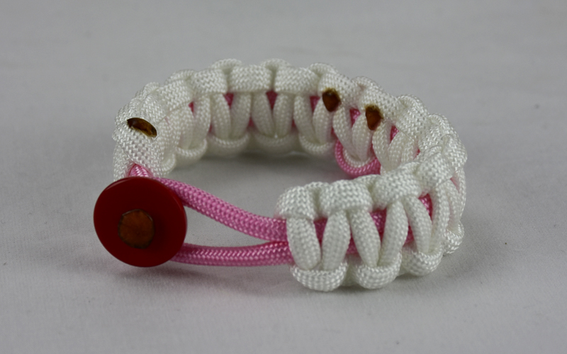 soft pink and white breast cancer support paracord bracelet with red button front and soft pink ribbon