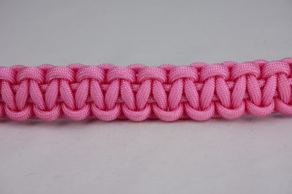 soft pink paracord bracelet unity band across the center of a white background