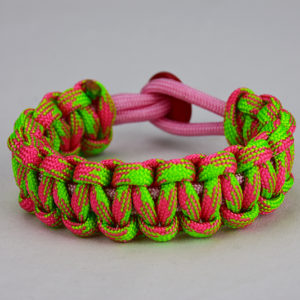 soft pink pink and neon green camouflage paracord bracelet unity band with red button back, picture of a soft pink pink and neon green camouflage paracord bracelet with a red button fastener on a white background