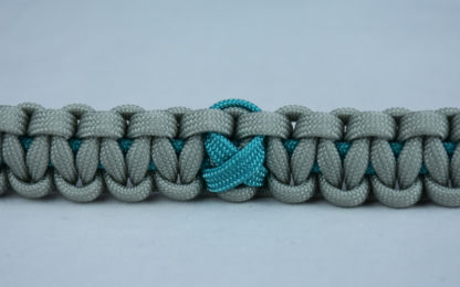 teal and grey ptsd support paracord bracelet with center teal ribbon