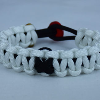 black and white pow mia support paracord bracelet with red button back and black ribbon