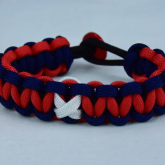 black navy blue and red multiple sclerosis support paracord bracelet with red button fastener in the back and white ribbon