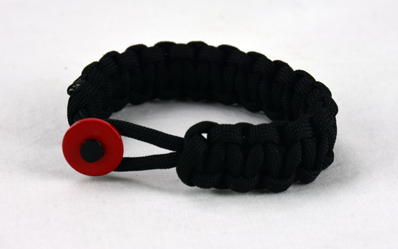 black paracord bracelet with red button front