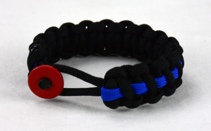 black paracord bracelet with blue line and red button fastener in the front