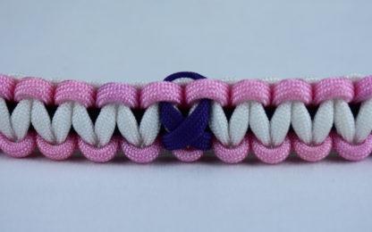 black soft pink and white alzheimers support paracord bracelet with purple ribbon in the center of a white background