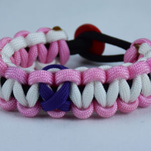black soft pink and white alzheimers support paracord bracelet with red button in the back and purple ribbon