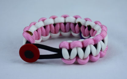black soft pink and white alzheimers support paracord bracelet with red button in the front and a purple ribbon