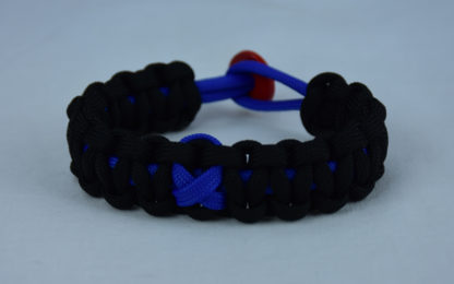 blue and black anti-bullying paracord bracelet with red button in the back and blue ribbon