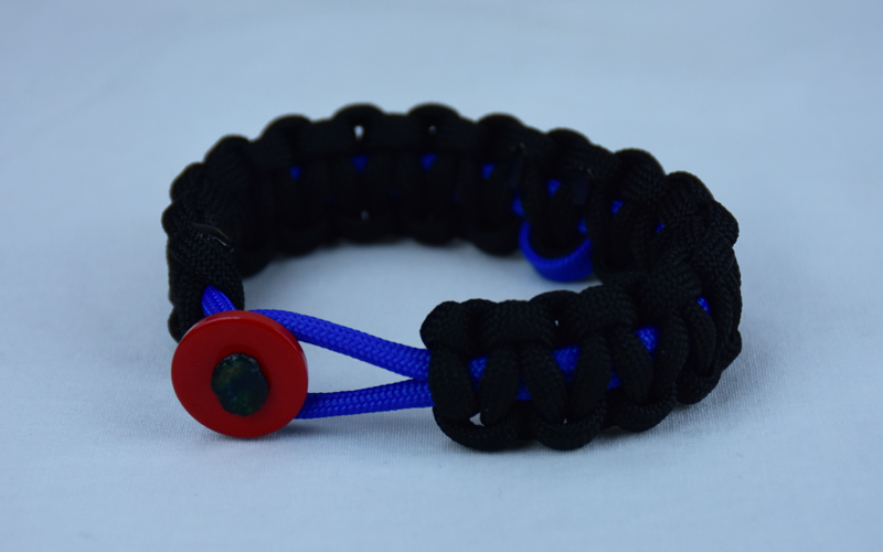 blue and black anti bullying paracord bracelet with red button front and blue ribbon