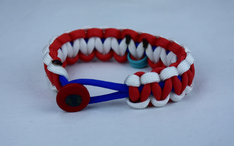 blue white and red ptsd support paracord bracelet with red button in front and teal ribbon
