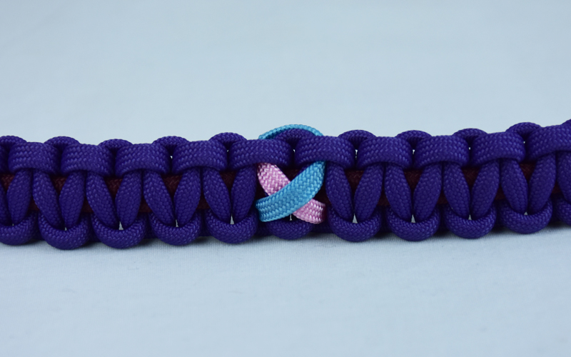 burgundy and purple sids support paracord bracelet with tarheel blue and pink ribbon in the center