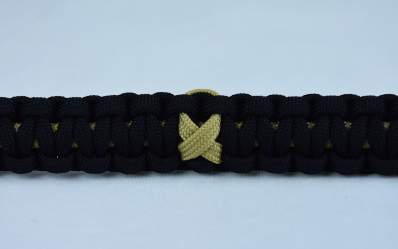 gold and black pediatric cancer support paracord bracelet with gold ribbon in the center