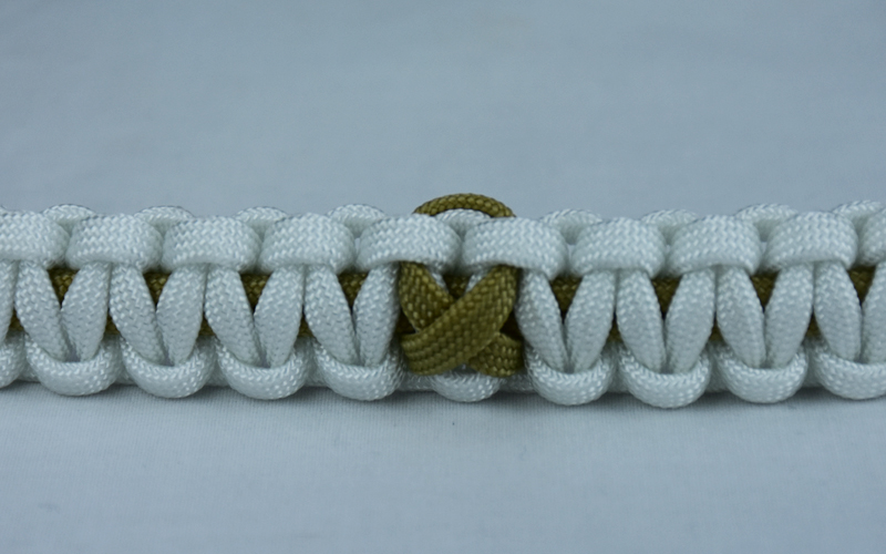 gold and white pediatric cancer support paracord bracelet with gold ribbon in the center
