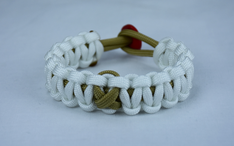 gold and white pediatric cancer support paracord bracelet with red button in the back and gold ribbon