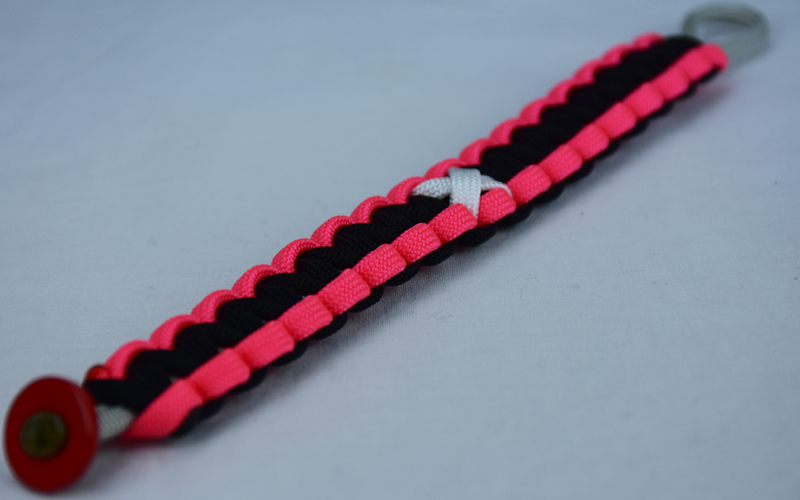 grey pink and black multiple sclerosis support paracord bracelet with red button in the corner and white ribbon