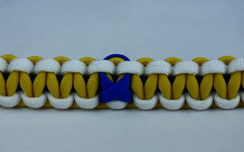 navy blue white and yellow anti bullying paracord bracelet with blue ribbon in the center