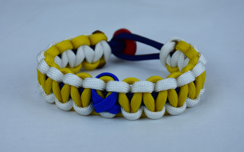 navy blue white and yellow anti bullying paracord bracelet with red button fastener in the back and blue ribbon