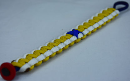 navy blue white and yellow anti bullying paracord bracelet with red button in the bottom corner and blue ribbon