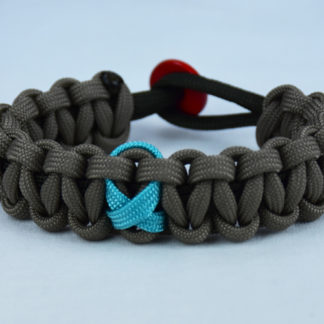 od green and tan ptsd support paracord bracelet with red button in back and teal ribbon