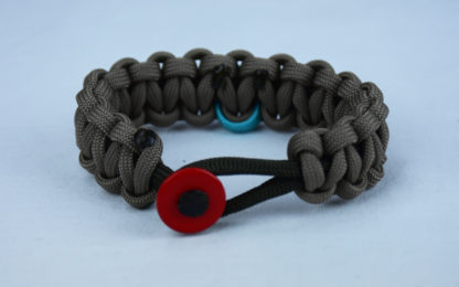 od green and tan ptsd support paracord bracelet with red button in front and teal ribbon