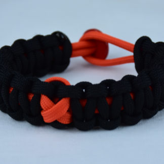 orange and black leukemia support paracord bracelet with red button in the back and orange ribbon
