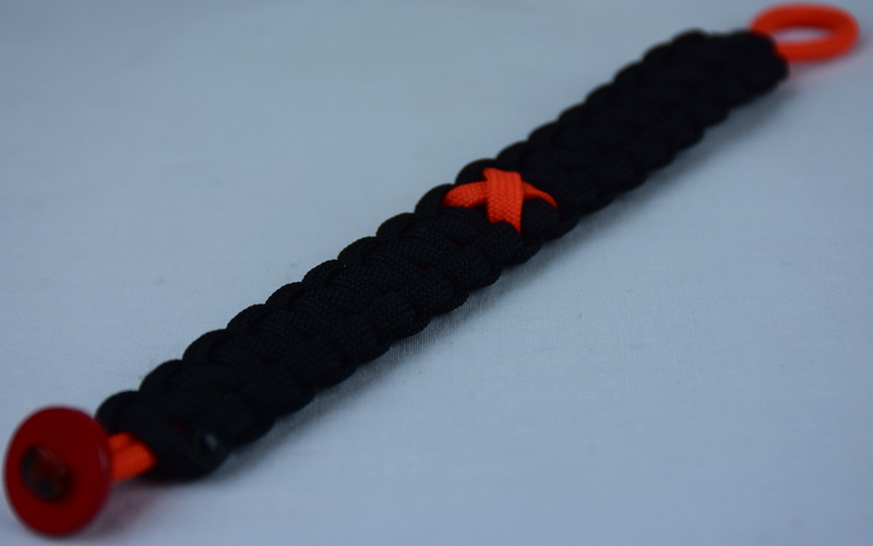 orange and black leukemia support paracord bracelet with red button fastener in the bottom corner and orange ribbon