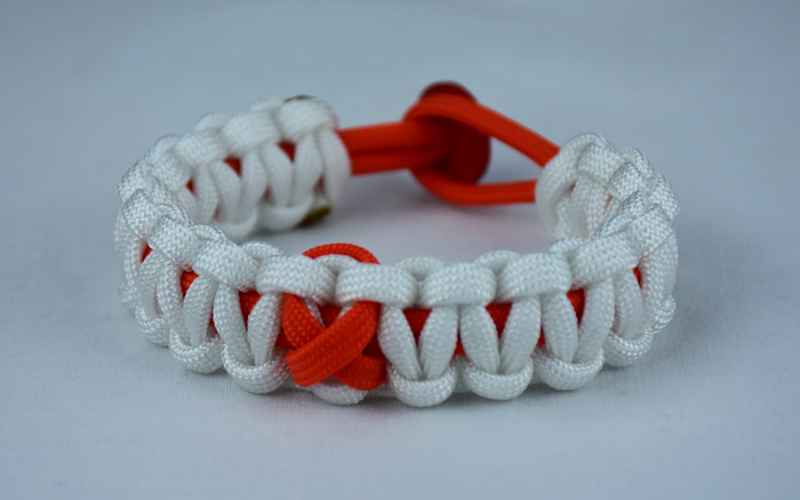 orange and white leukemia support paracord bracelet with red button in the back and orange ribbon