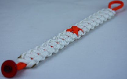orange and white leukemia support paracord bracelet with red button in the bottom corner and orange ribbon
