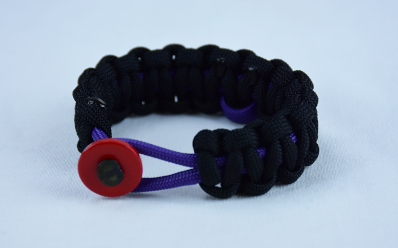 purple and black alzheimers support paracord bracelet with red button in the front and purple ribbon