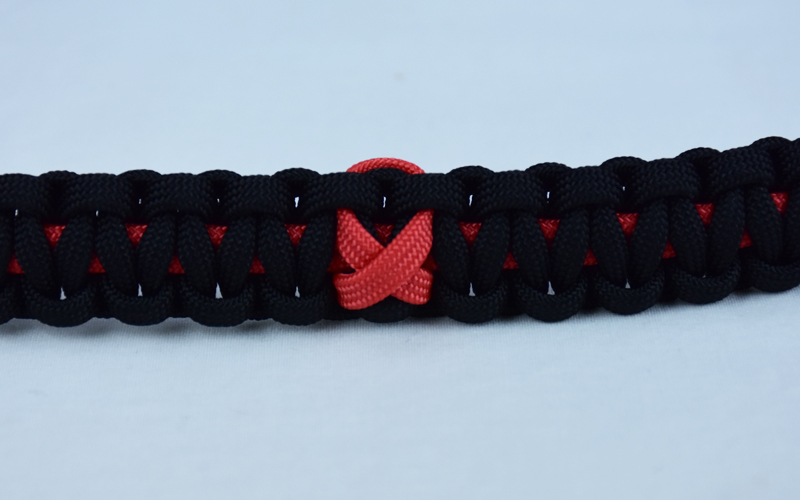 red and black heart disease support paracord bracelet with red ribbon in center