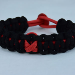 red and black heart disease support paracord bracelet with red button back and red ribbon