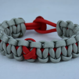 red and grey heart disease support paracord bracelet with red button back and red ribbon