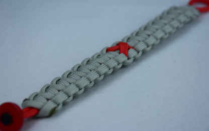 red and grey heart disease support paracord bracelet with red button corner and red ribbon