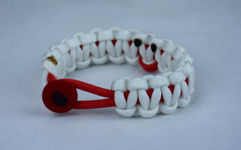 red and white heart disease support paracord bracelet with red button front and red ribbon