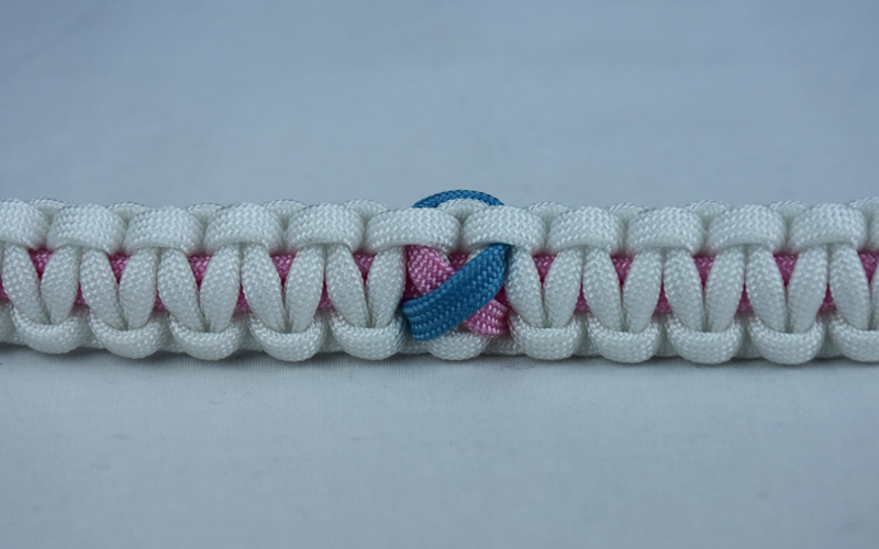 soft pink and white sids support paracord bracelet with tarheel blue and pink ribbon