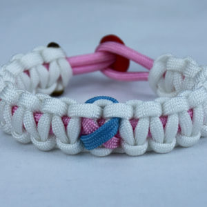 soft pink and white sids support paracord bracelet with red button back and tarheel blue and pink ribbon