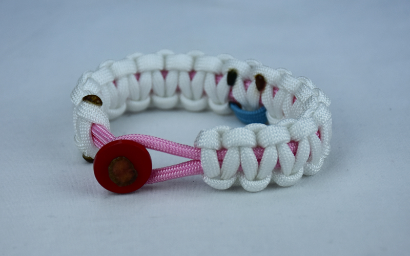 soft pink and white sids support paracord bracelet with red button front and tarheel blue and pink ribbon