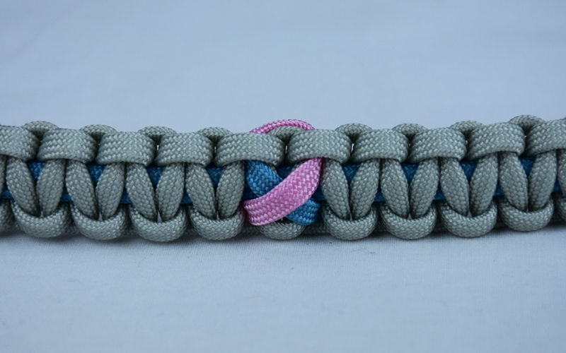 tarheel blue and grey sids support paracord bracelet with tarheel blue and pink ribbon in the center