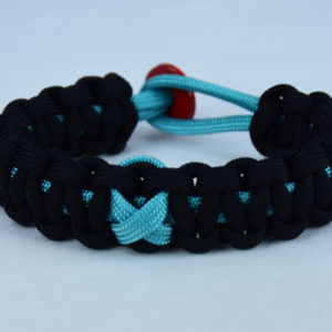 teal and black ptsd support paracord bracelet with red button back and teal ribbon