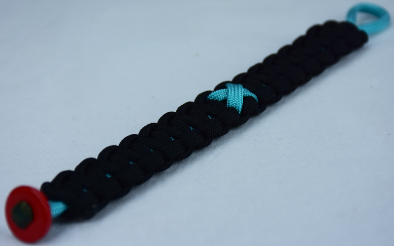 teal and black ptsd support paracord bracelet with red button in the bottom corner and teal ribbon