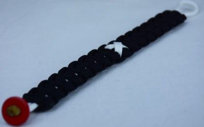 white and black multiple sclerosis support paracord bracelet with red button corner and white ribbon