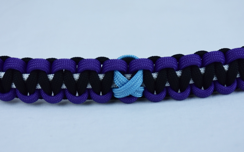 white purple and black prostate cancer support paracord bracelet with tarheel blue ribbon in center