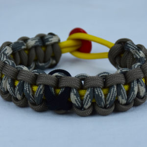 yellow tan and desert sand foliage camouflage pow mia support paracord bracelet with red button back and black ribbon